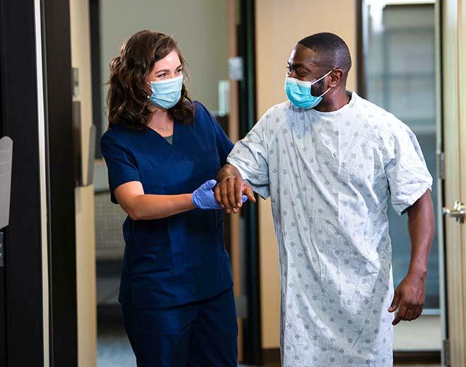 nurse helping patient leave hospital