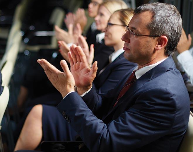 award-executives-applauding-man