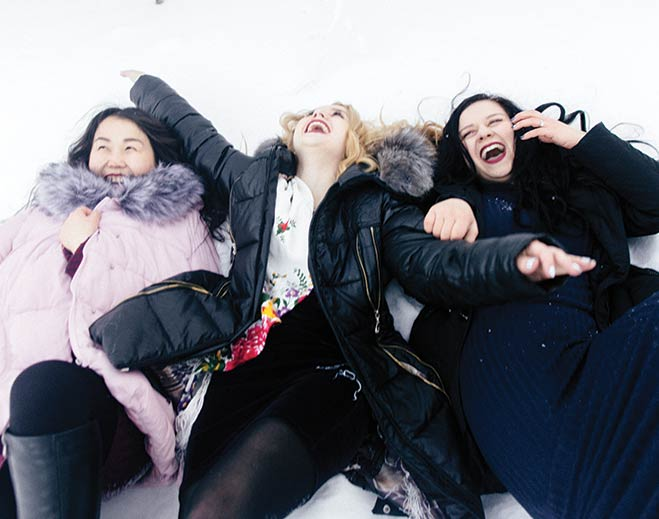 community-family-three-women-playing-snow
